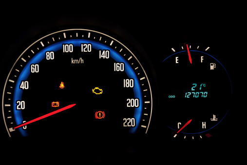 Car meter dashboard on black background