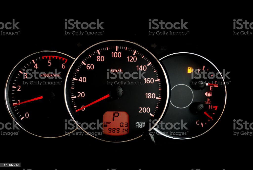 Car mileage monitor with Empty fuel warning light stock photo