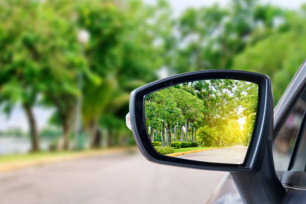 Car mirror side rear-view mirror on a car. bending over backwards stock pictures, royalty-free photos & images