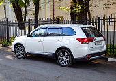 istock Car Mitsubishi Outlander parked at the edge of the roadway. 1055700772