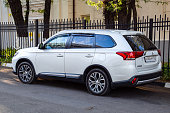 istock Car Mitsubishi Outlander parked at the edge of the roadway. 1055700774