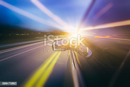 157590217 istock photo Car moving fast at night 599470882