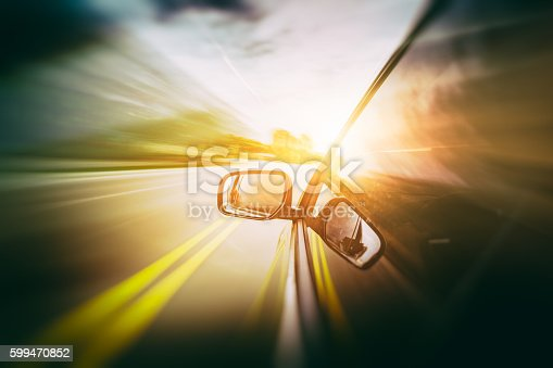 157590217 istock photo Car moving fast 599470852