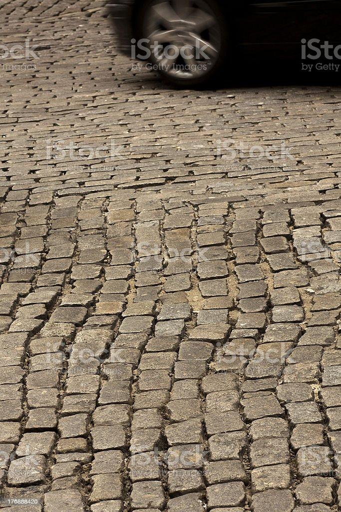 car moving on cobblestone royalty-free stock photo