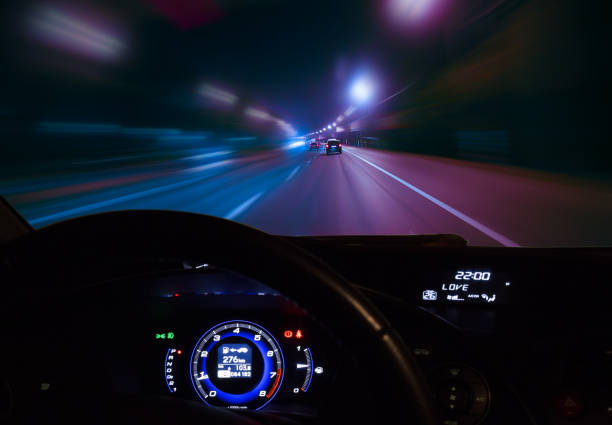 car moving on highway at night view from moving car on highway at night dashboard vehicle part stock pictures, royalty-free photos & images