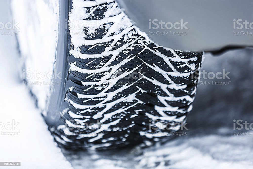 Car M+S tire in snow royalty-free stock photo