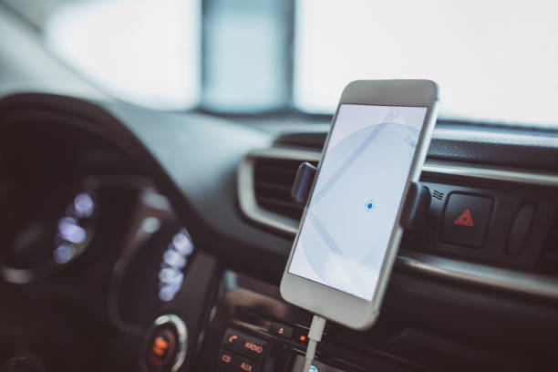 Car navigation A mobile phone inside a car used for navigation global positioning system stock pictures, royalty-free photos & images