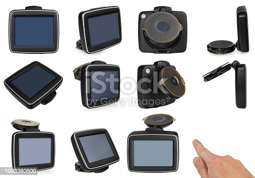 GPS car navigation with handle. The finger indicates the point on the satellite navigation screen. Black electronic map device with blue screen and silver border. Satellite navigation device isolated on white background.