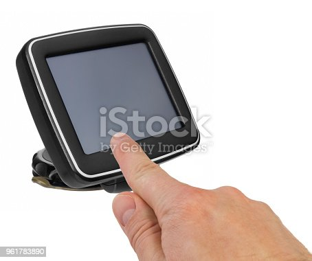 istock GPS car navigation with handle. The finger indicates the point on the satellite navigation screen. 961783890