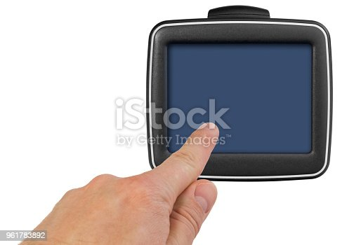 istock GPS car navigation with handle. The finger indicates the point on the satellite navigation screen. 961783892