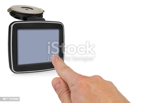 istock GPS car navigation with handle. The finger indicates the point on the satellite navigation screen. 961783896