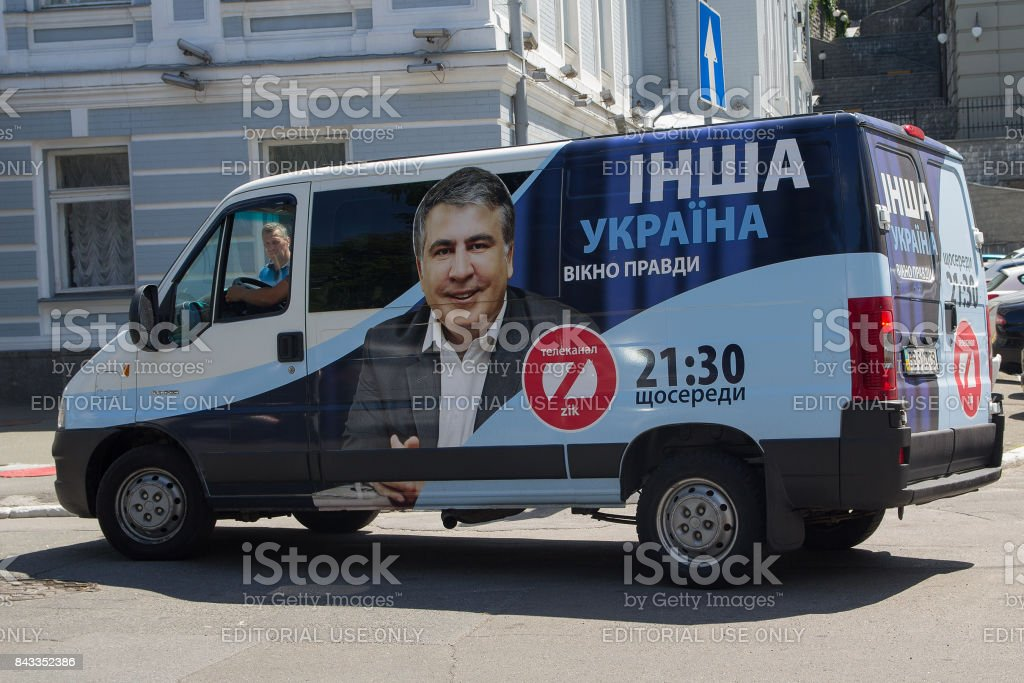 Car of the TV channel ZIK with the outdoor advertising of the TV show of the authorship of the disgraced politician Mikhail Saakashvili. The inscription on the car 'Ukraine: The Window of Truth' in Ukrainian. stock photo