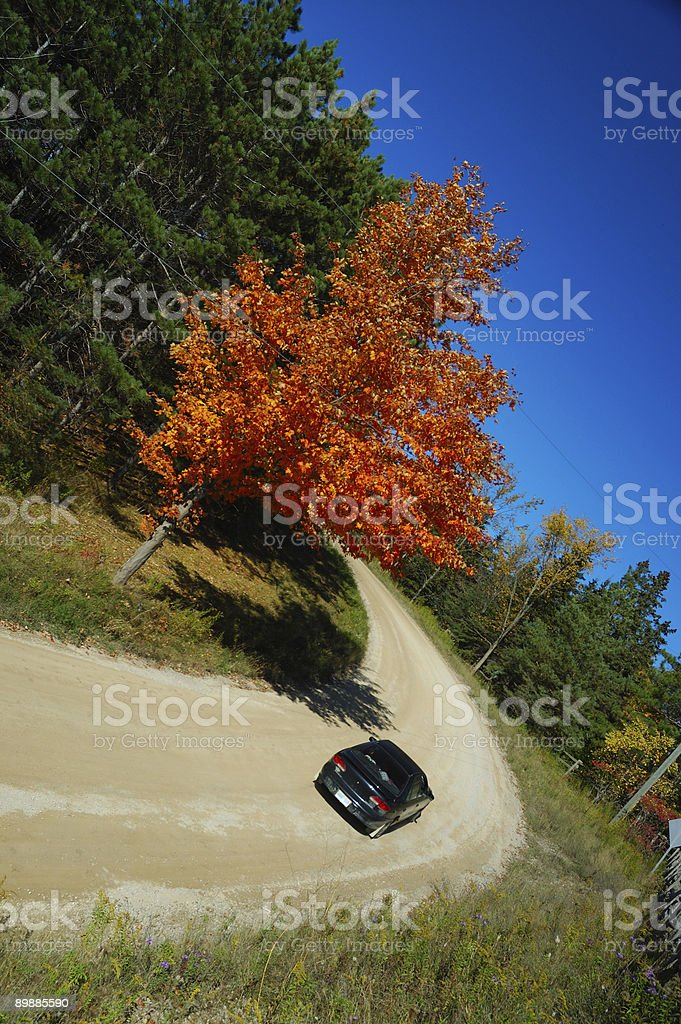 Car on a autumn country road royalty-free stock photo