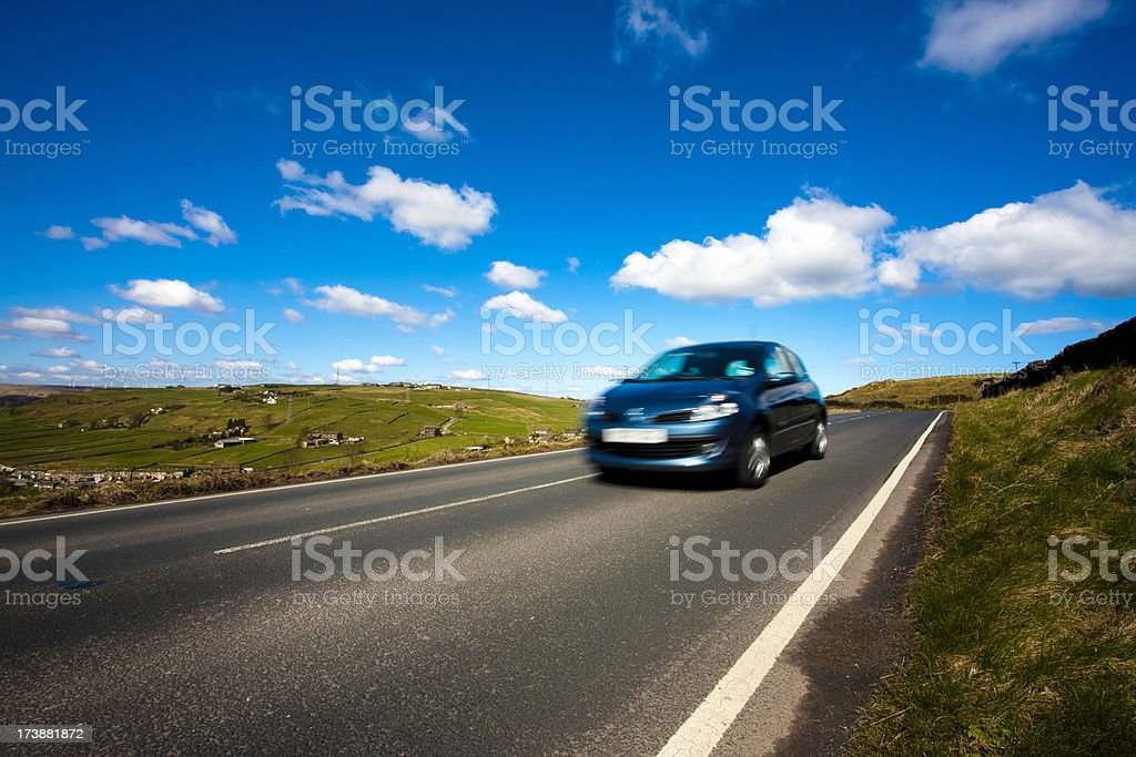 Car on a country road stock photo