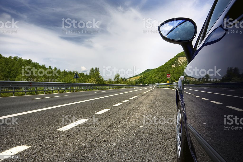 car on a road in the countryside stock photo