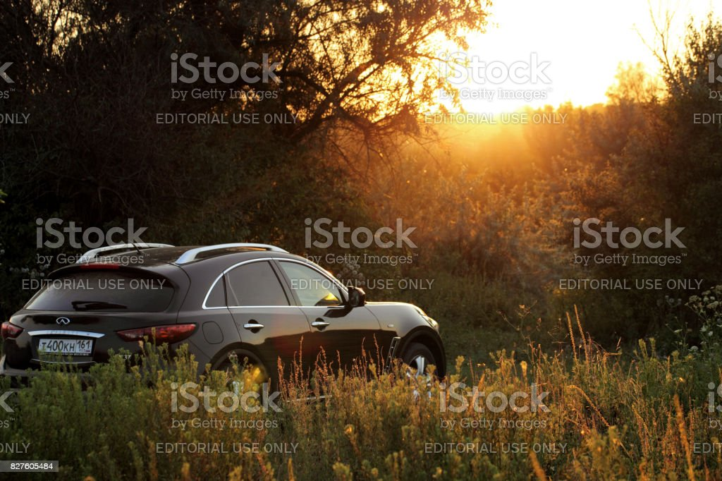 Car on a sunset background.