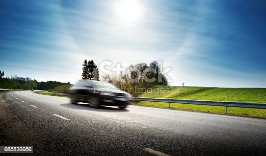 istock Car on asphalt road in beautiful spring day 685836656