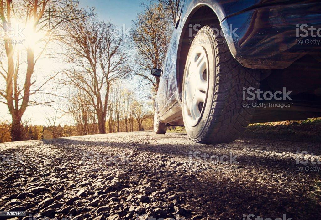 Car on asphalt road in spring morning stock photo