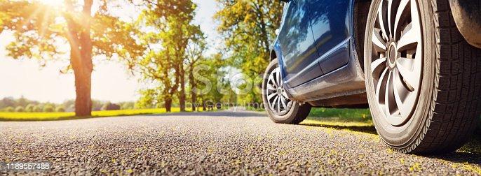 istock Car on asphalt road in summer 1189557488