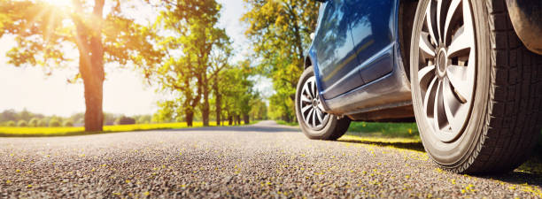 Car on asphalt road in summer Car on asphalt road on summer day at park car stock pictures, royalty-free photos & images