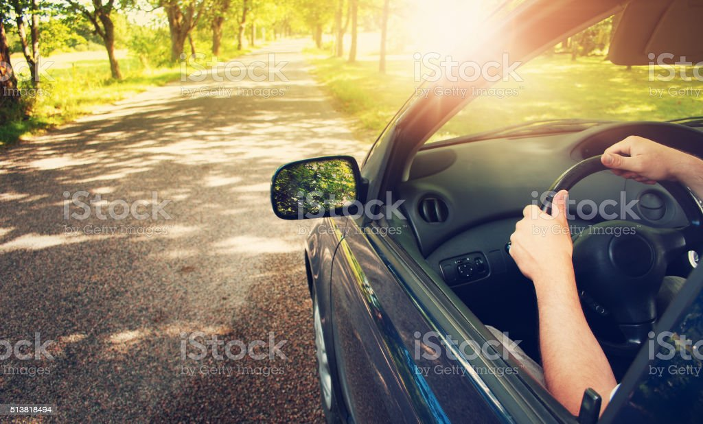 Car on asphalt road in summer stock photo