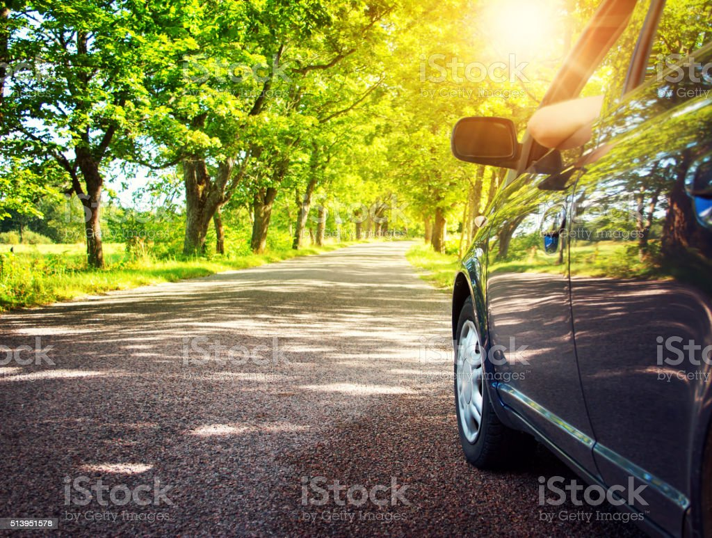 Car on asphalt road in summer​​​ foto