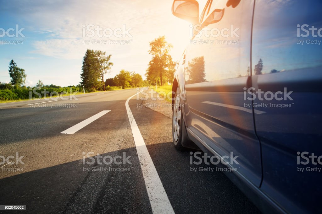 Car on asphalt road in summer stock photo