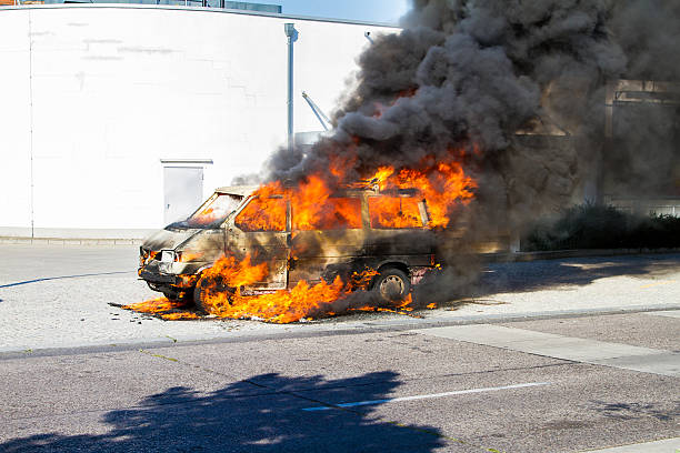 Car on fire Car on fire in the street with flames blazing riot police stock pictures, royalty-free photos & images
