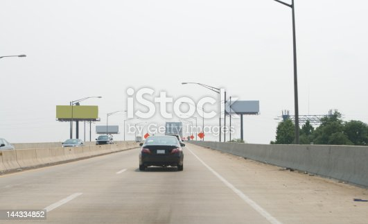istock Car on Highway Pennsylvania Turnpike Jersey Barrier USA 144334852