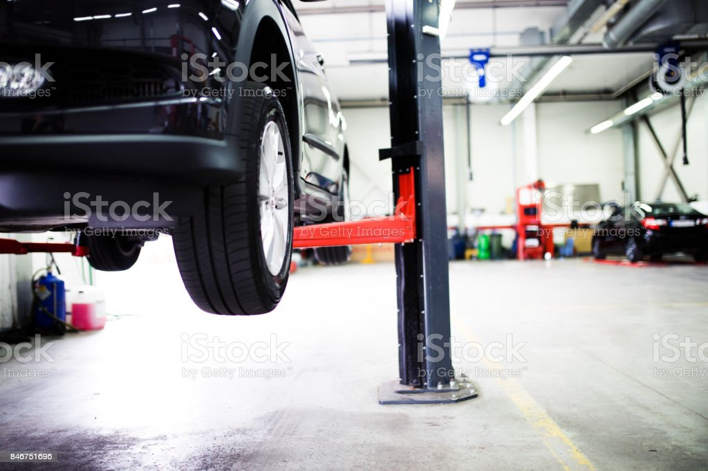 Car on lift at car service stock photo