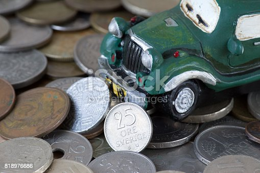 istock Car on old coins 818976686