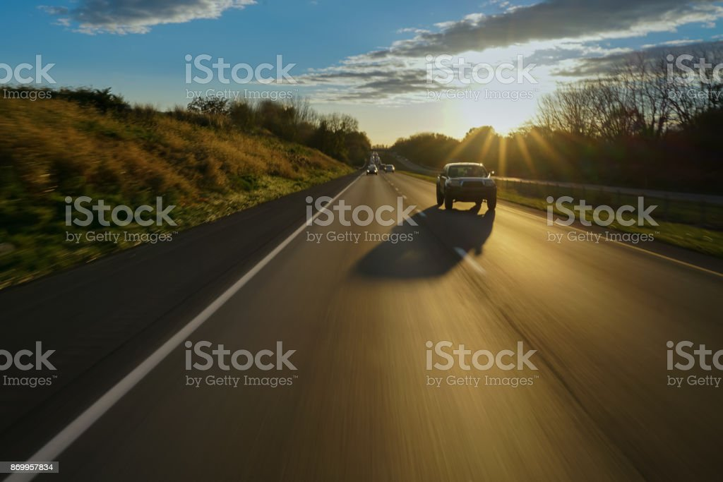Car on open road at suset stock photo