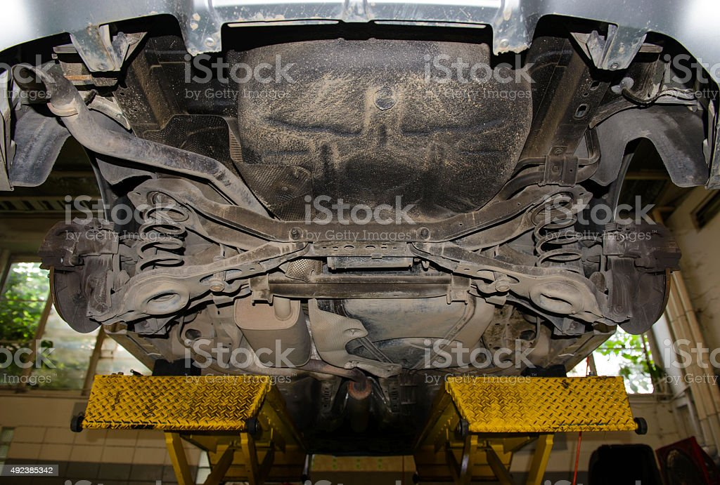 Car on repair stand stock photo