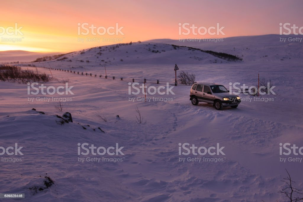Car on the arctic road in day time. Murmansk Region, stock photo