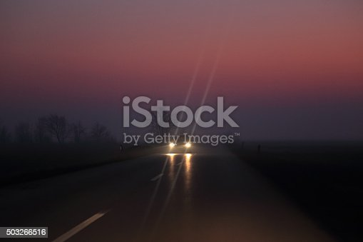 istock Car on the night road at the sunset 503266516