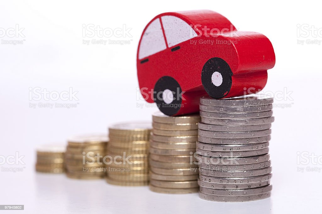 A car on top of stack coins on a white background royalty-free stock photo