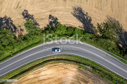 istock Car on Winding Road, Aerial View 1178852269