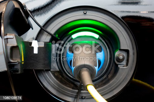 istock EV Car or Electric car at charging station with the power cable supply plugged. Eco-friendly alternative energy concept. 1080109174
