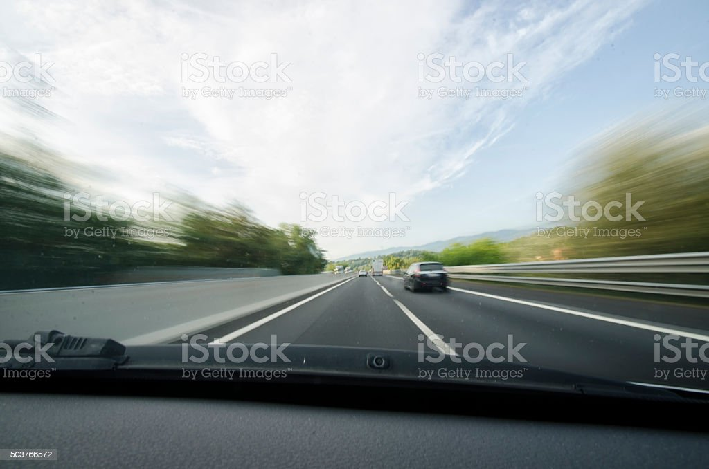 Car overtaking on a motorway stock photo