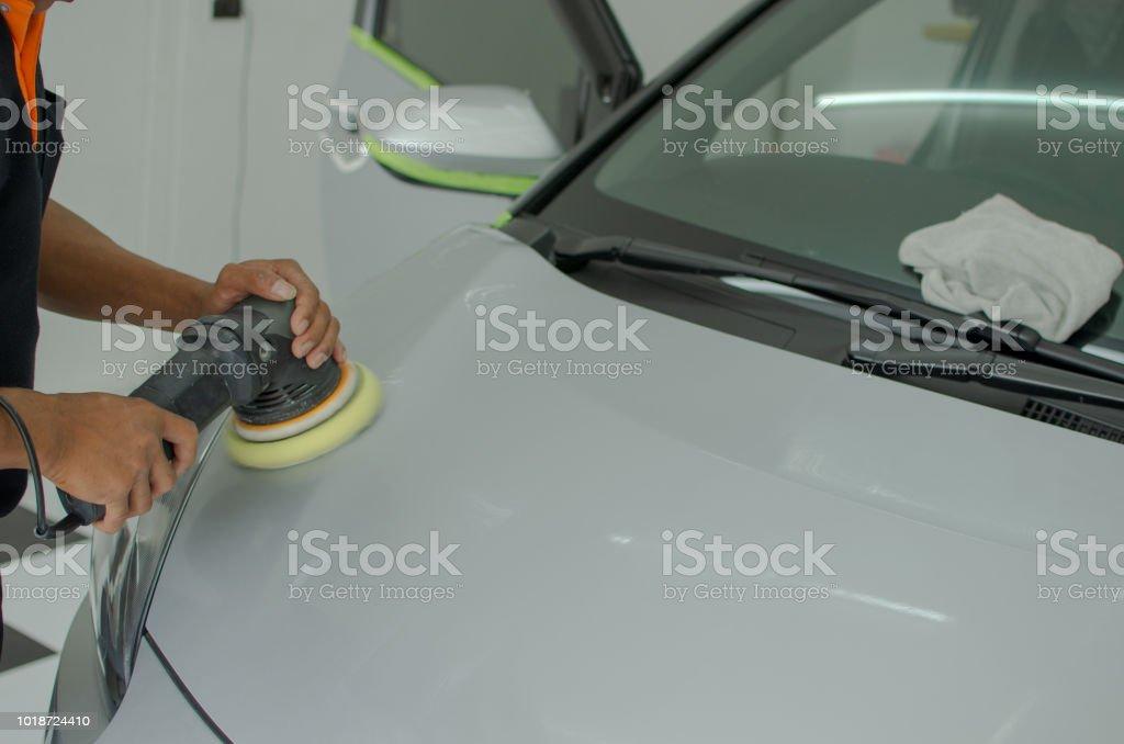 car paint polishing stock photo