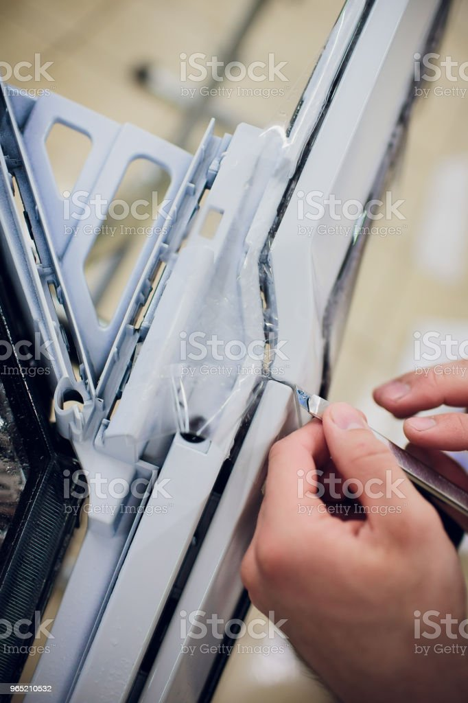 Car paint protection, protect coating installation carving knife royalty-free stock photo