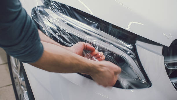 car paint protection, protect coating installation - avvolgere foto e immagini stock