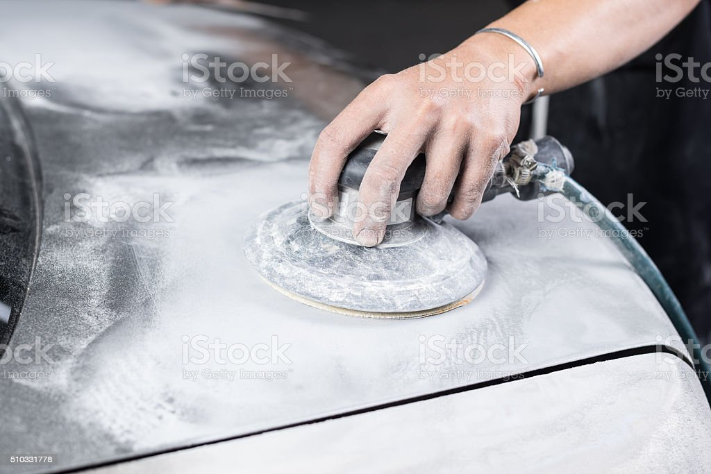 Car paint repair series : Sanding paint stock photo