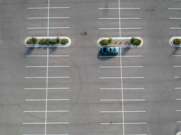 A car parked at a large parking lot. stock photo