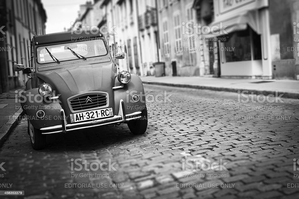 A Citroen 2CV, the French car myth, was parked in a beautiful street...