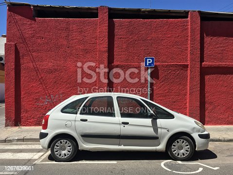 Valencia, Spain - August 16, 2020: Modern white car parked in place reserved for handicapped drivers. There are lots of place for this all around the city