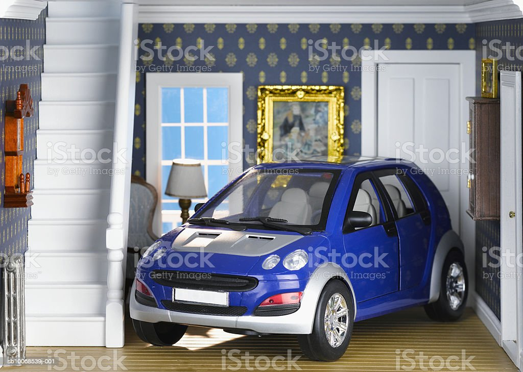 Car parked in living room of model house, close-up royalty-free stock photo