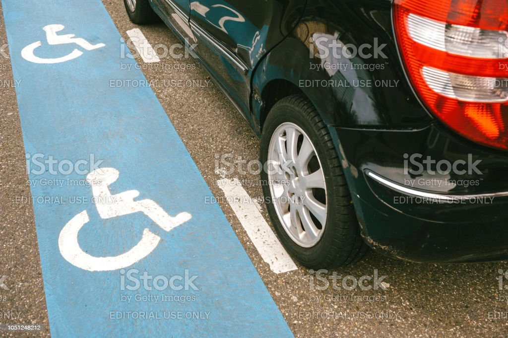 Car parked on the disabled blue sign stock photo