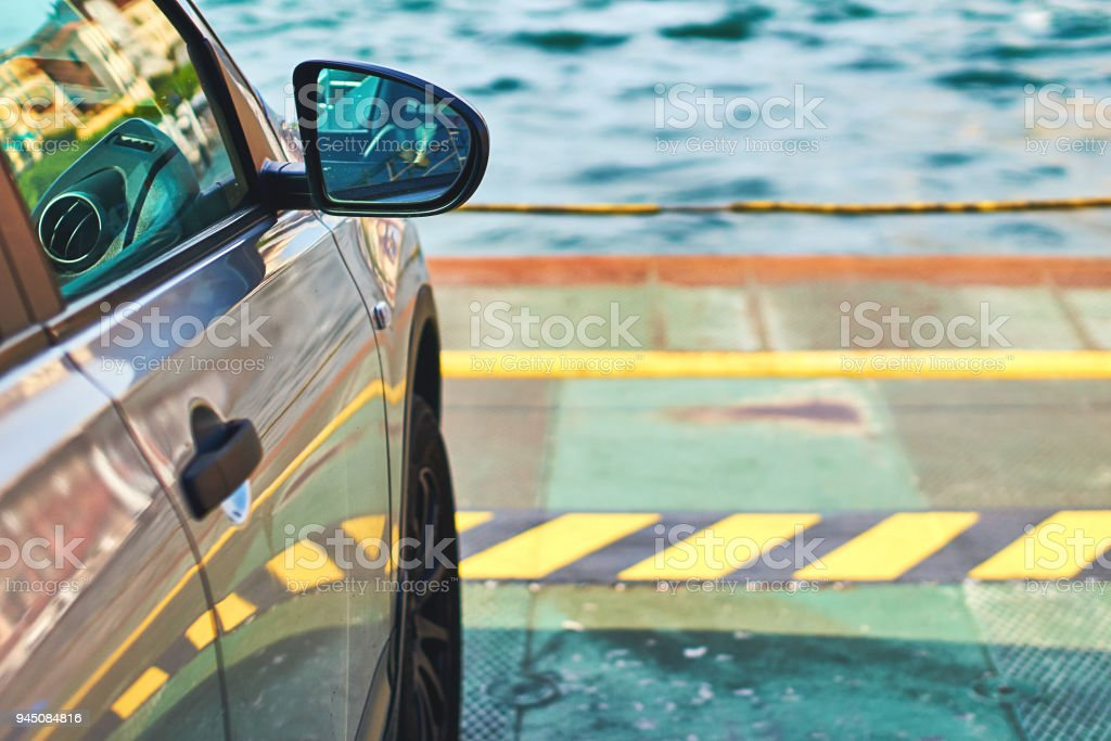 Car parked on the ferry with copy space and water on background stock photo