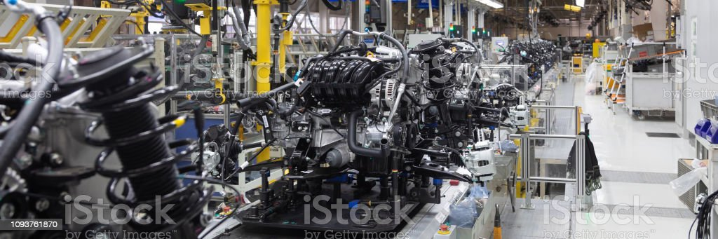 Part of car suspension. Wide format shooting at car factory. Car...
